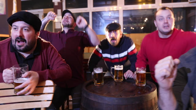 Supporters watching a game in pub