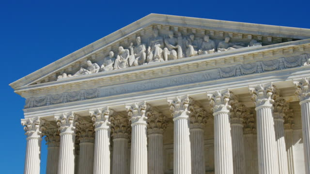 U.S. Supreme Court Ediface U.S. Supreme Court Pan of front ediface shot in 4K. supreme court stock videos & royalty-free footage