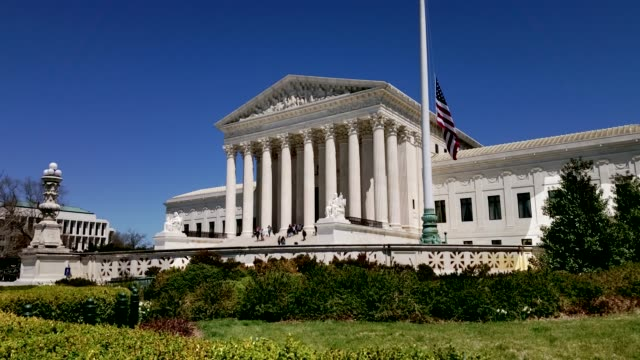 Supreme Court of the United States and American Flag in Washington, DC Wide View of the United States Supreme Court with American Flag - Washington DC supreme court stock videos & royalty-free footage
