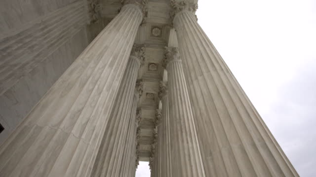 Supreme Court of the United States Columns Tilt Down in Washington, DC Tilt Down Shot of the United States Supreme Court Columns in Washington DC - supreme court stock videos & royalty-free footage