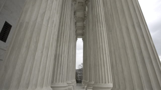 Supreme Court of the United States Columns Tilt Up in Washington, DC Tilt Up Shot of the United States Supreme Court Columns in Washington DC - supreme court stock videos & royalty-free footage