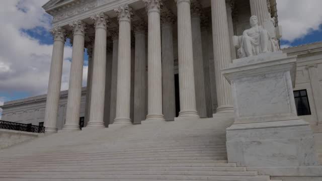 Supreme Court of the United States in Washington, DC - 4k/UHD United States Supreme Court - Washington DC - Tilt-Up in 4K/UHD supreme court stock videos & royalty-free footage