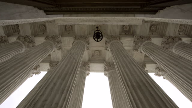 Supreme Court of the United States in Washington, DC Tilt Down Shot of the United States Supreme Court Columns in Washington DC - supreme court stock videos & royalty-free footage