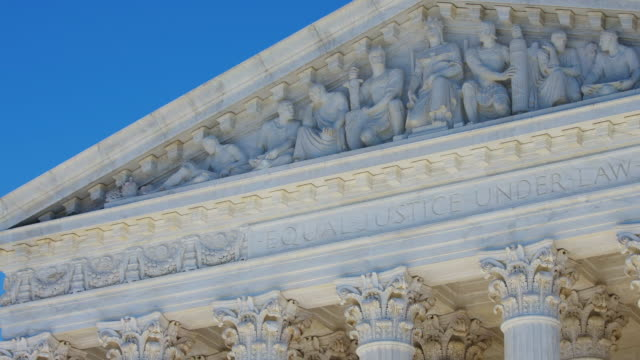U.S. Supreme Court time lapse U.S. Supreme Court time lapse taken over several hours with sun revealing statues shot in 4K. supreme court stock videos & royalty-free footage