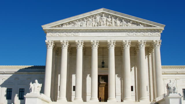 U.S. Supreme Court U.S. Supreme Court pan of front of building shot in 4K. supreme court stock videos & royalty-free footage