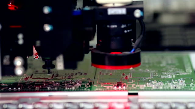 Surface Mount Technology Machine places elements on circuit boards Surface Mount Technology Smt Machine places elements on circuit boards. HD. electrical equipment stock videos & royalty-free footage