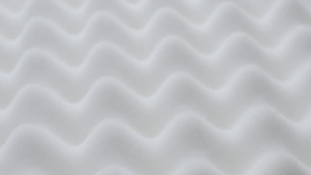 Surface of memory foam topper with peak and valley form close-up 4K 3840X2160 30fps UltraHD tilting video - Slow tilt over foam mattress luxurious texture 4K 2160p UHD footage