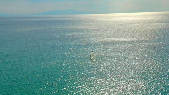 A surfer at the sea of Halkidiki at summer  in Greece video