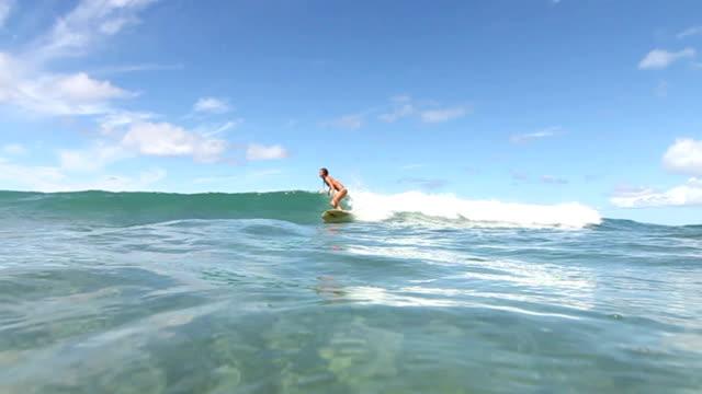 Surfer Girl Riding Longboard video