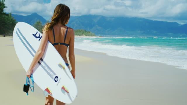 Surfer Girl Walking Down the Beach video