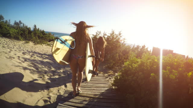 Surfer girls high-five and go video