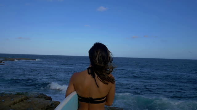 Surfer in bikini video