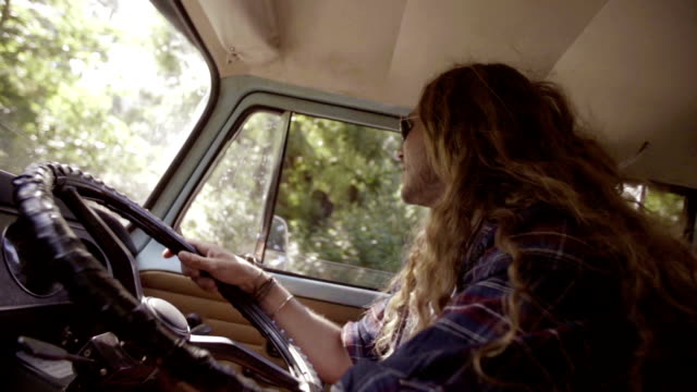 Surfer is driving his camper van Surfer is driving his camper van rv interior stock videos & royalty-free footage