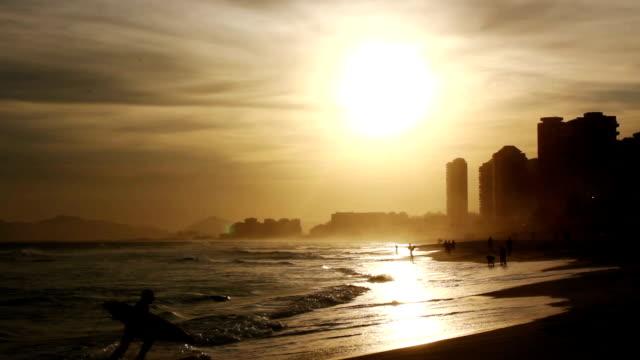 Surfer leaving the water in Rio de Janeiro video