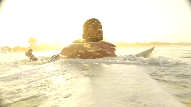 SLOW MOTION: Surfer paddling at sunset in Sri Lanka video
