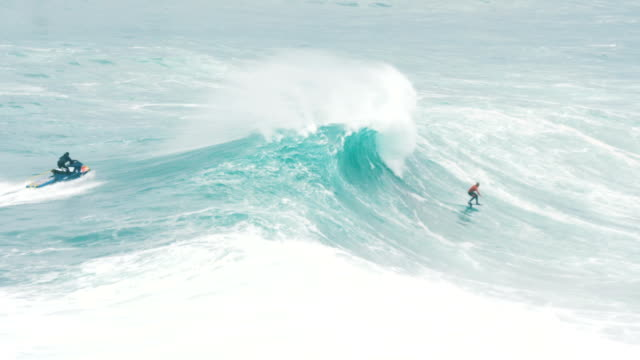 surfer rides a giant wave on a surf hydrofoil, slow motion