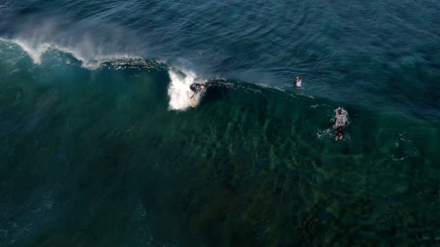 AERIAL: Surfer riding a big wave video