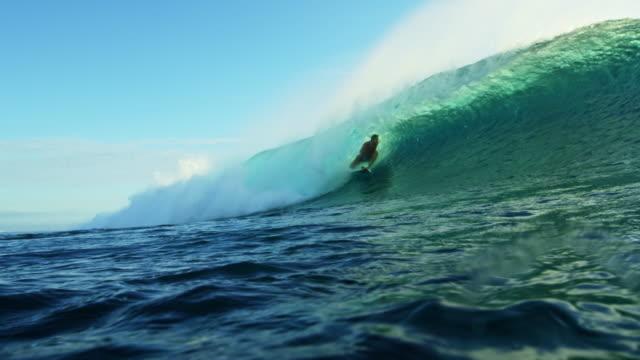 Surfer Riding Ocean Wave