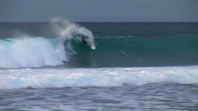 Surfer slashes