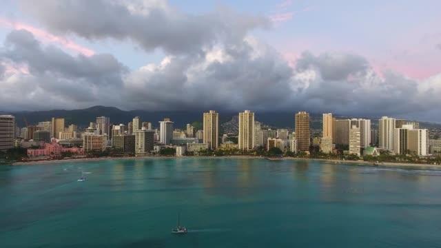 Surfers and Hotels Waikiki Beach Honolulu Oahu Hawaii Drone Video