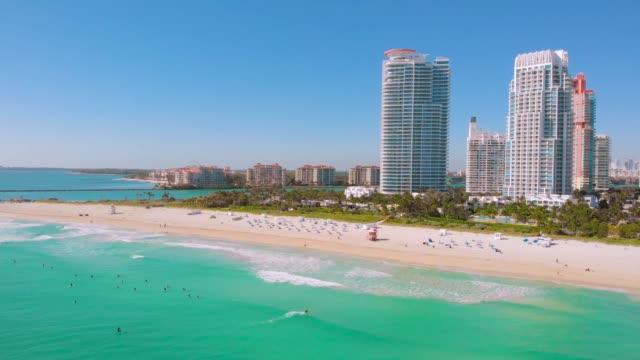 Surfers ride surfs in the ocean waves. Miami Beach video