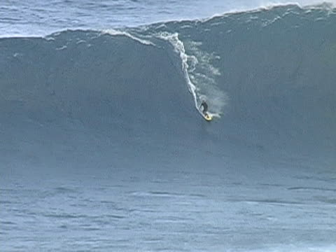Surfing Jaws Maui Surfing a huge wave at Jaws, Maui large stock videos & royalty-free footage
