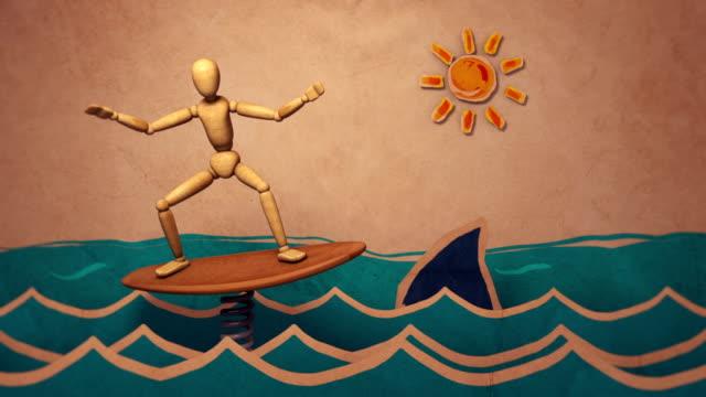 서핑 마네킹-모션 디자인 애니메이션/스톱 모션 스타일 - 스톱 모션 스톡 비디오 및 b-롤 화면