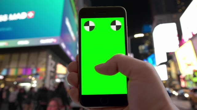 NYC surfing texting Time Square people crowd green screen chromakey video