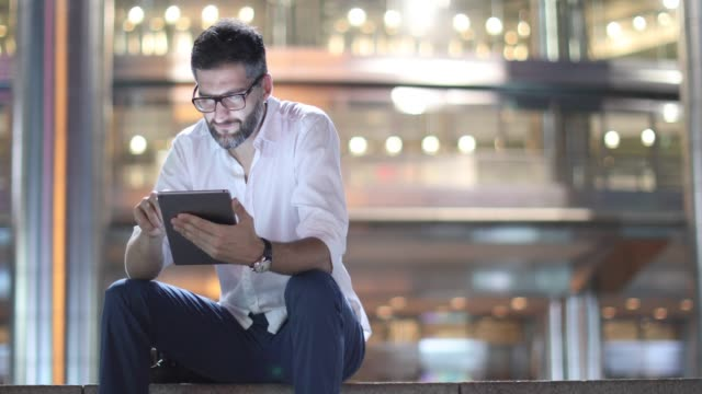Surfing the Net Outside Petronas Towers Young Caucasian Businessman Using Digital Tablet Outside Petronas Towers In Kuala Lumpur, Malaysia surfing the net stock videos & royalty-free footage