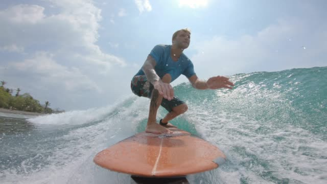 Surfing Surfing on a left breaking pointbreak surf stock videos & royalty-free footage