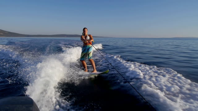 Surfing young woman video