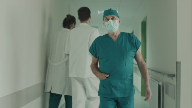 surgeon walking in hospital - face mask stock videos & royalty-free footage