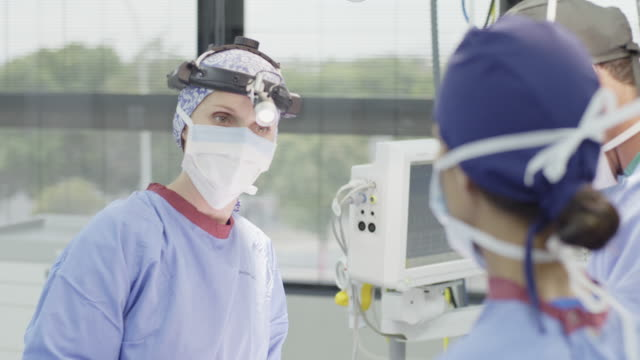 Surgeons communicating during operation video
