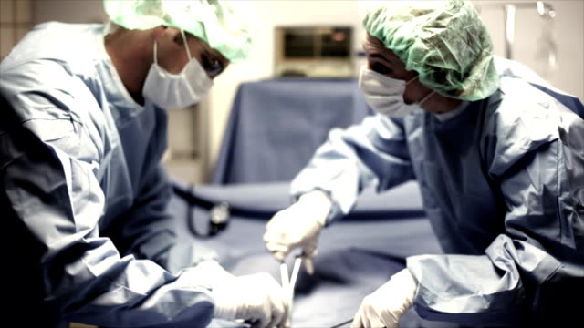 Surgeons Performing Surgical Procedure video