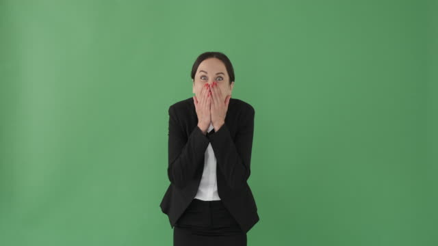 Surprise businesswoman covering mouth with hands