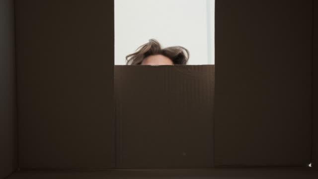 Surprise man unpacking carton box