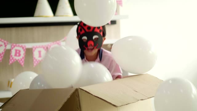 Surprise of hiding boy with birthday party Surprise of hiding boy with birthday party while standing for with positive emotion mask disguise stock videos & royalty-free footage