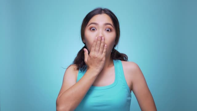 Surprise woman on isolated blue background 4k