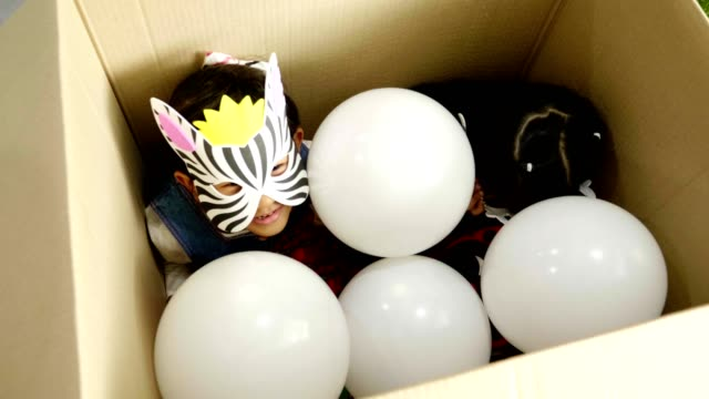 surprised box with children party surprised box with children party with animal mask theme and balloon mask disguise stock videos & royalty-free footage