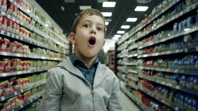 Surprised boy in supermarket video