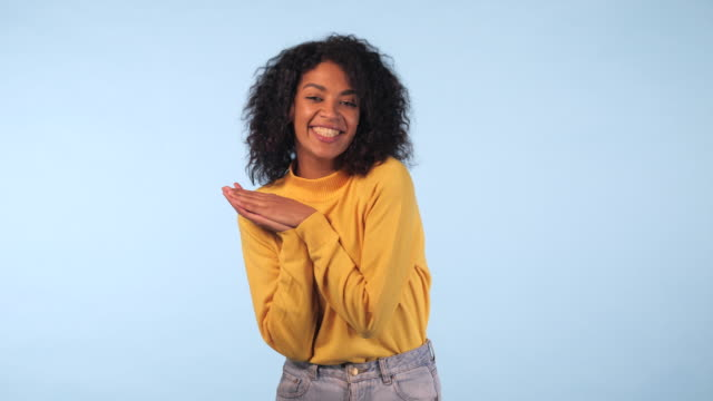Surprised excited happy woman closeup portrait of beautiful young woman with ecstatic face expressions. Winning young mixed race african female model on blue background. 4k