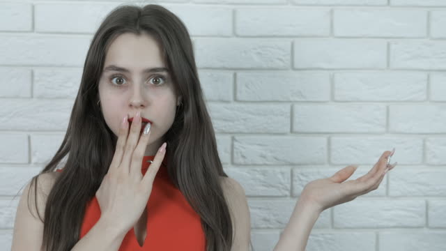 surprised girl offers a product. - eastern european descent stock videos & royalty-free footage