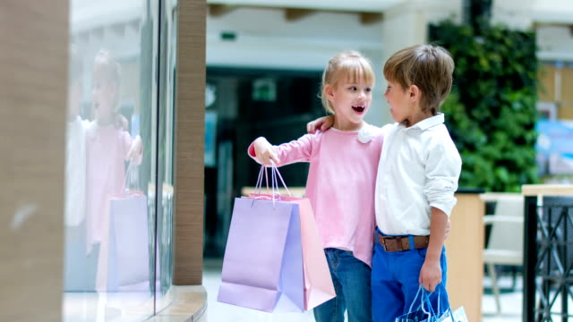 Surprised kids at the shopping center video
