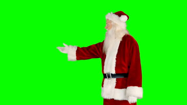 surprised santa claus gesturing - mani sui fianchi video stock e b–roll