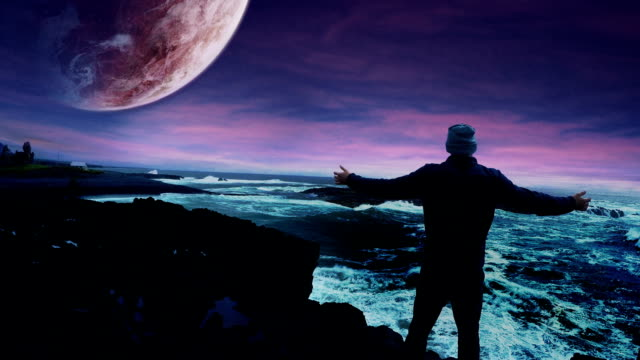 Surreal landscape. Colorful sky, huge waves and planet in background video
