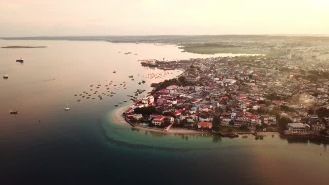 Surrounded by the sea 4k drone footage of a coastal city and boats in the ocean tanzania stock videos & royalty-free footage