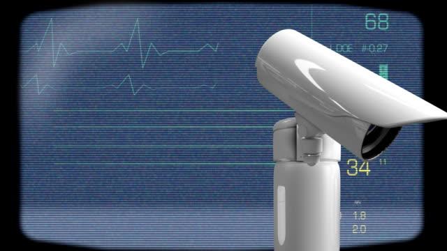 vídeos de stock e filmes b-roll de surveillance camera and heart rate - coração fraco