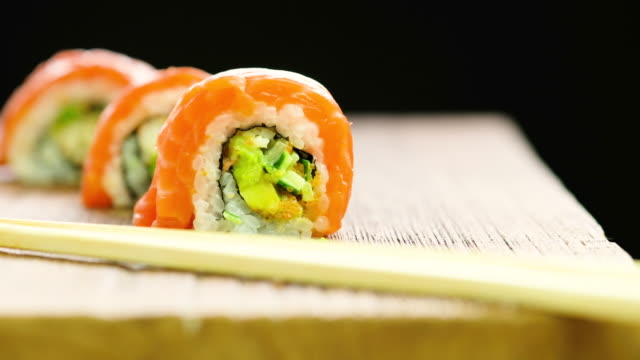 sushi black background video