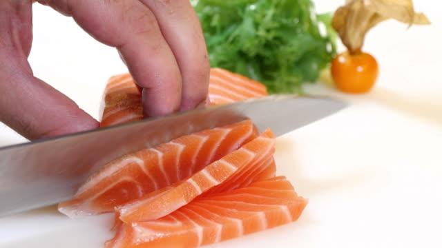 Sushi Chef Slices a Salmon Steak Nigiri Style video