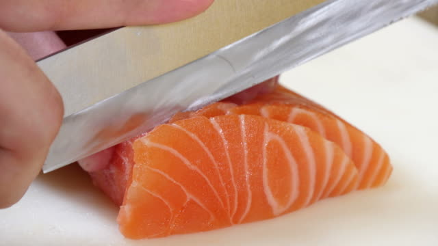 Sushi Chef Slicing a Salmon Steak Nigiri Style video